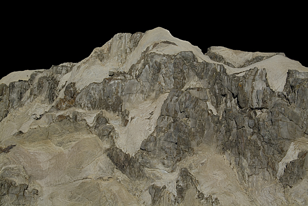 I love looking for images in natural rock formations that suggest something else.  EG here we have snow covered mountain range