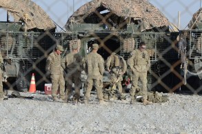 Soldiers from 1-14 Cav preparing for a mission in their Strykers