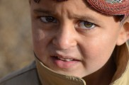 A little boy in Taj Murani looks a little puzzled as I snapped his picture