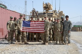 The FOB Bullard ADT Detachment with CPT Collins' flag. CPT Collins was our Vet for the first half of our mission.