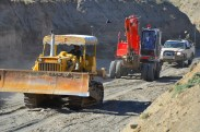 The dozer & backhoe coming down the wadi with an ANA escort