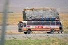 A bus rolling past FOB Al Masaak