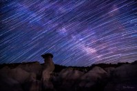 Starry Streaks Across the Milky Way star trail photo of Paint Mines Colorado by Dan Bourque