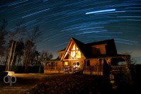 Star Trails over the Cabin star trail photo over Look Out Lodge Kentucky by Dan Bourque