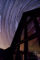 Stars Swirling Above the Cabin star trail photo over Look Out Lodge Kentucky by Dan Bourque