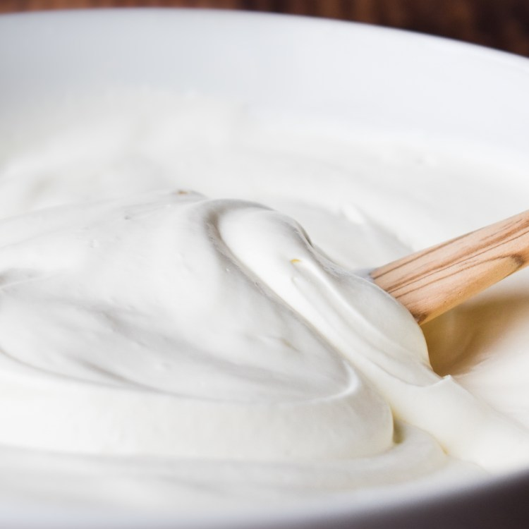 Whipped Cream Frosting being stirred