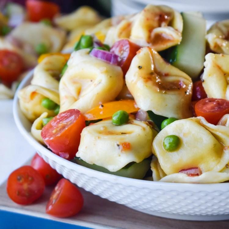 tortellini pasta salad in a white bowl