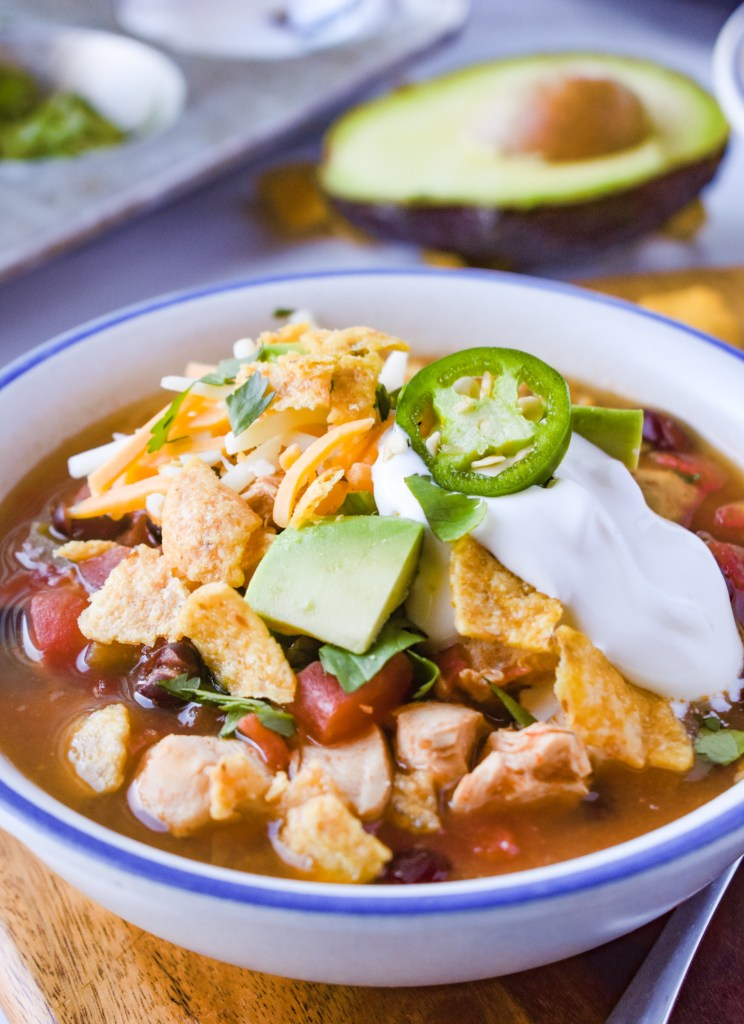 Bowl of Mexican Chicken Soup with toppings
