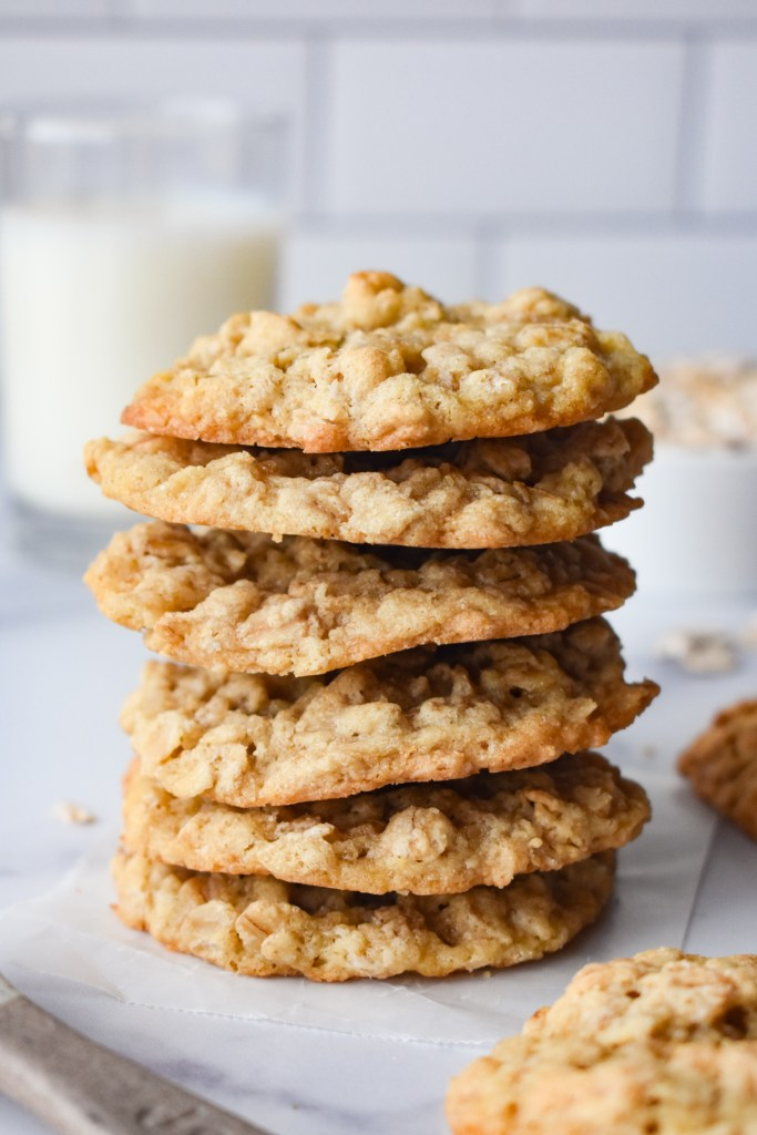 Stack of chewy oatmeal cookies with milk
