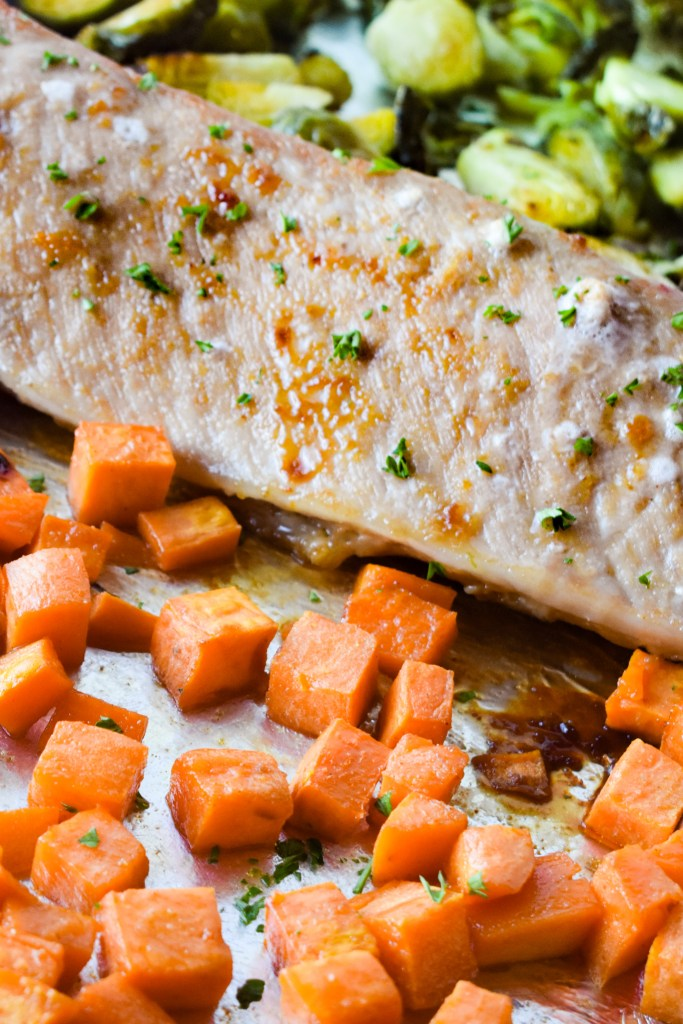 Pork Loin with brussels sprouts and diced sweet potatoes on a sheet pan