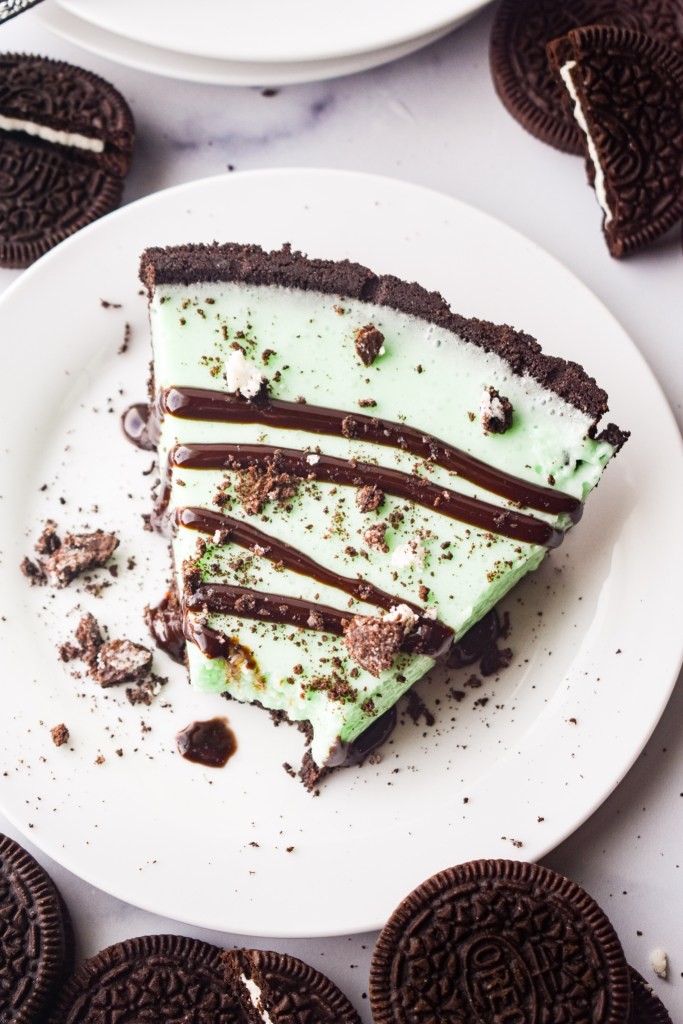 Grasshopper Pie on a white plate with chocolate drizzle