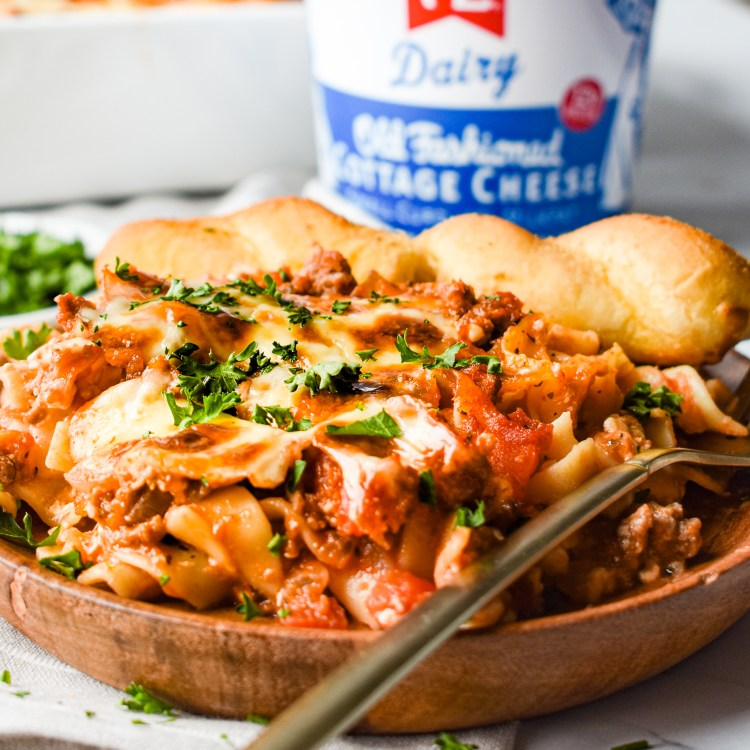 Plate of Lasagna Casserole with a breadstick