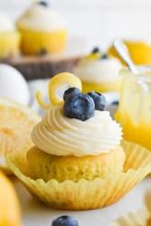 lemon blueberry cupcake on a white surface