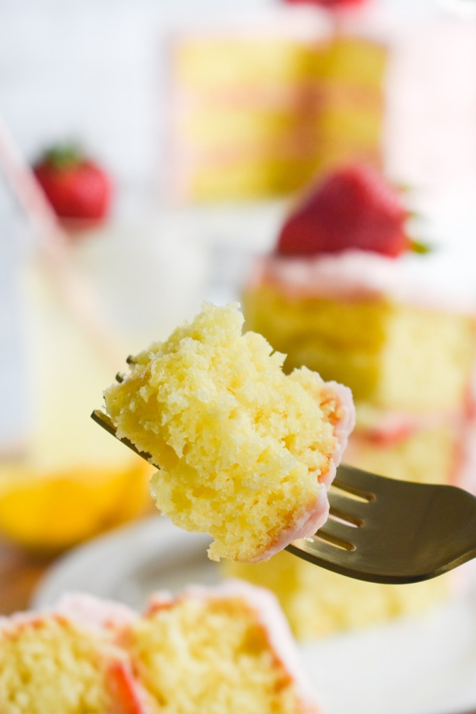 Bite of strawberry lemonade cake on a fork