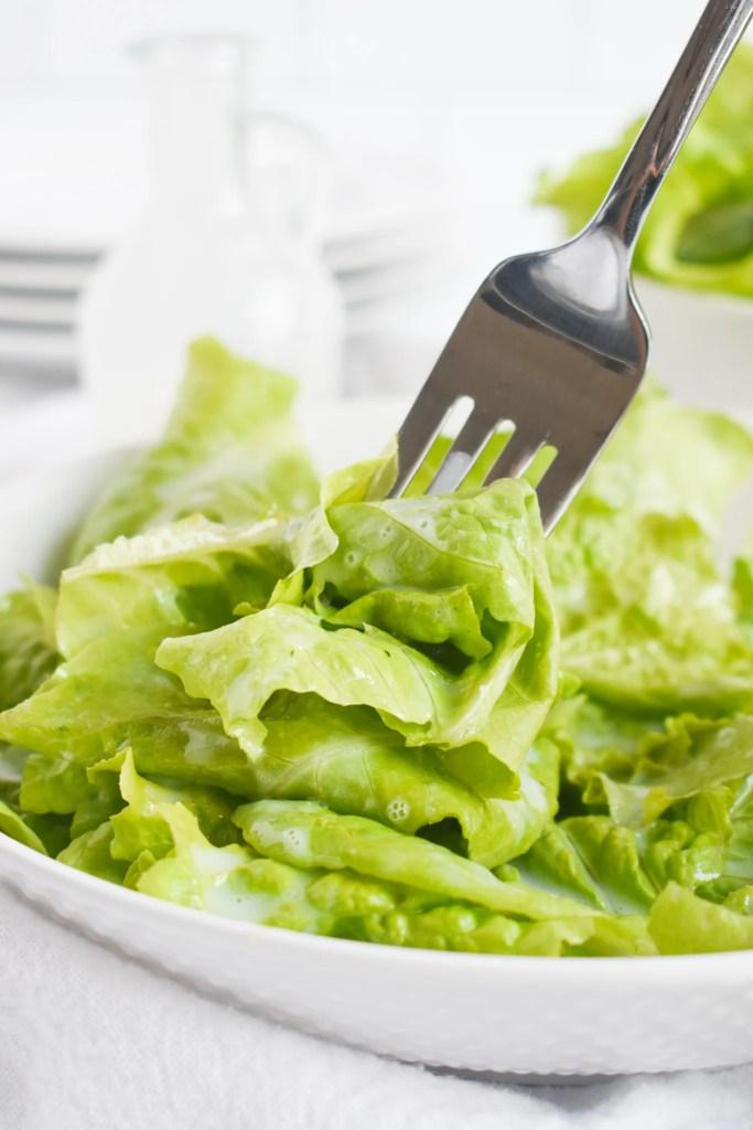 Garden Lettuce Dressing on lettuce on a silver fork