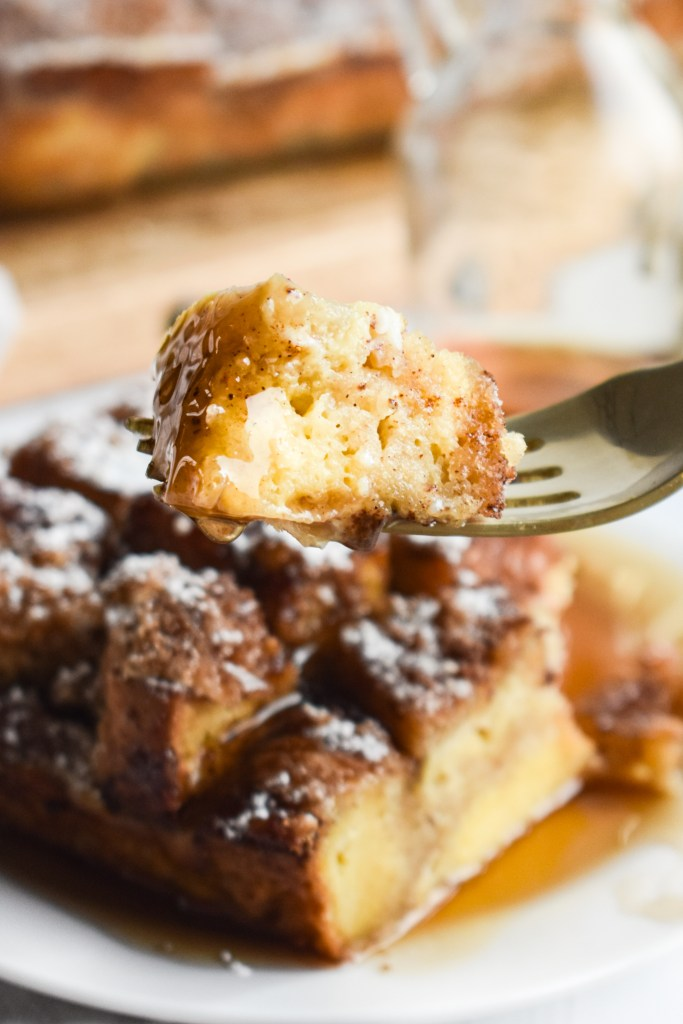bite of French toast casserole on a gold fork