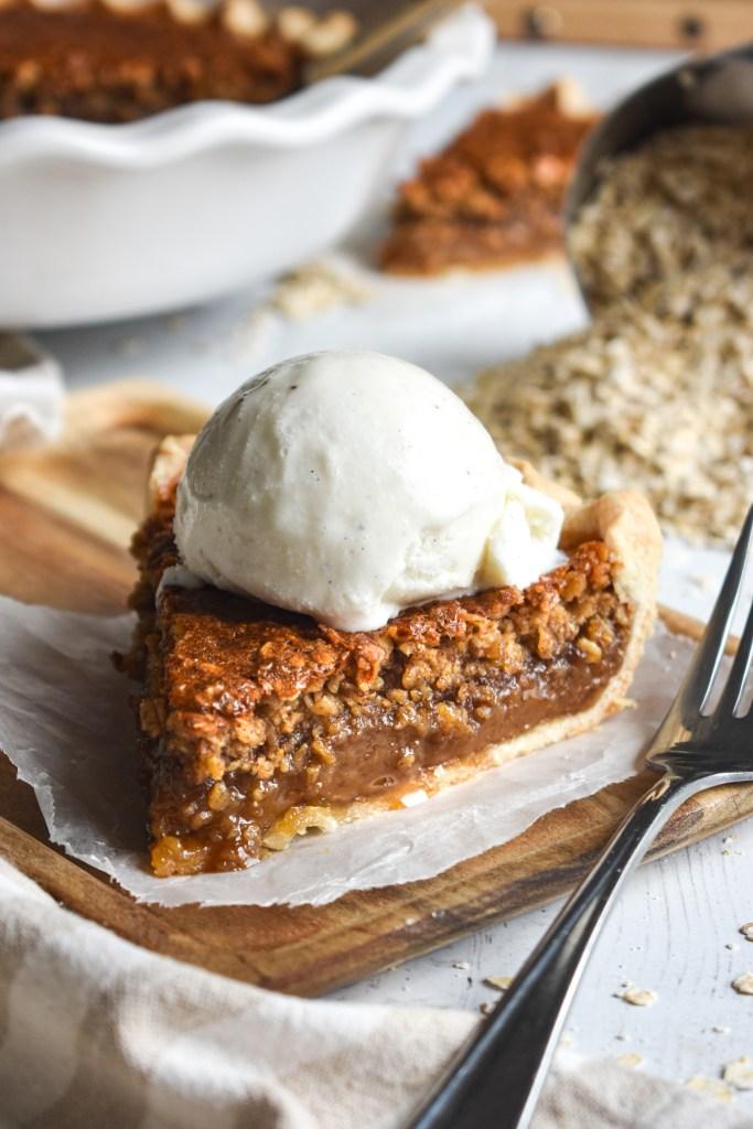 slice of oatmeal pie with vanilla bean ice cream on top