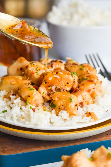 Honey Garlic Chicken with sauce being poured on top
