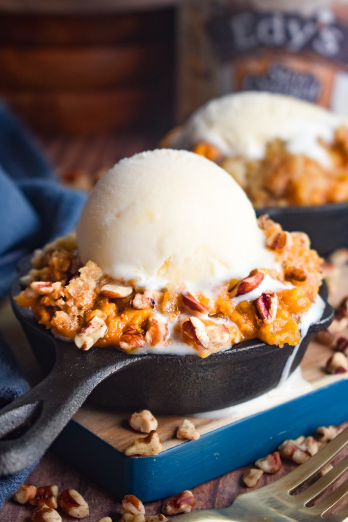 pumpkin dump cake in a cute little cast iron skillet with ice cream on top