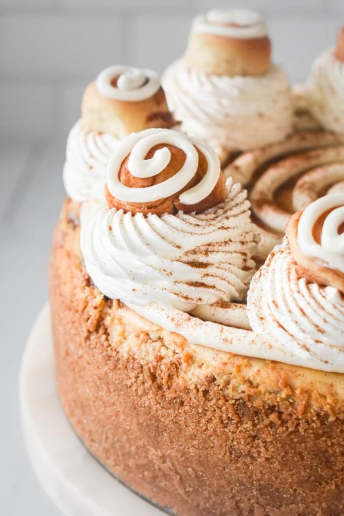cinnamon roll cheesecake on a platter