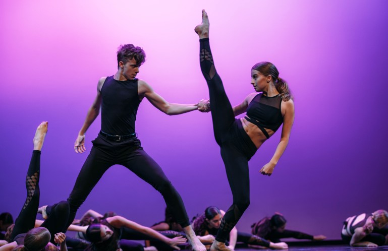 Two dancers, male and female, perform at annual recital for Downtown Dance Factory.