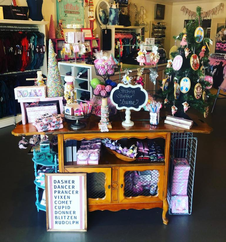"Tabletop display at Attitude Dance Boutique, with stocking stuffers and sign ""Stocking Stuffer Barre"""
