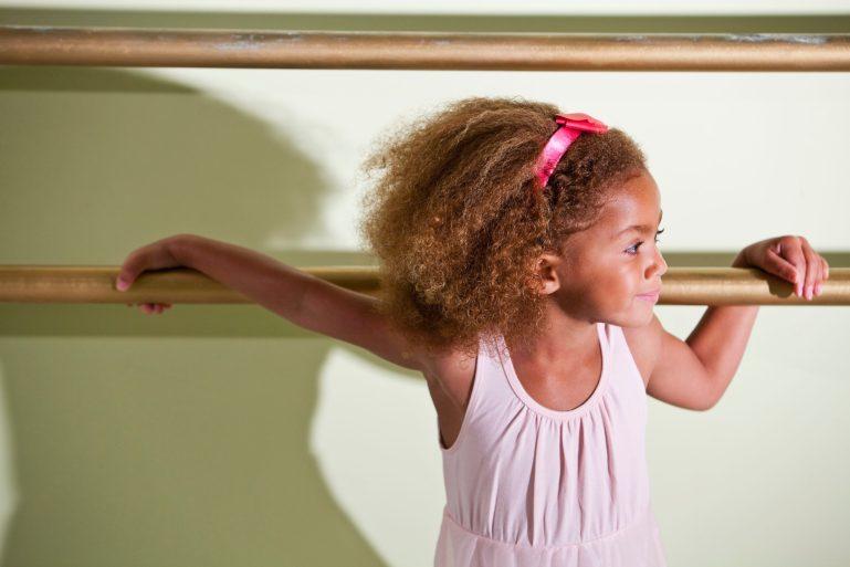 Little girl (4 years) in ballet costume in dance studio.