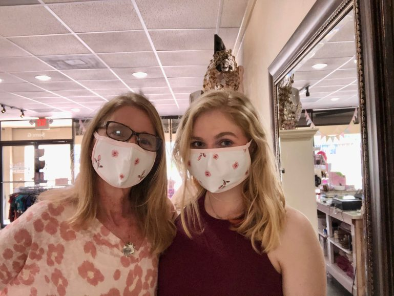 Emily Mayerhoff and her daughter wearing masks at Attitude Dance Boutique.
