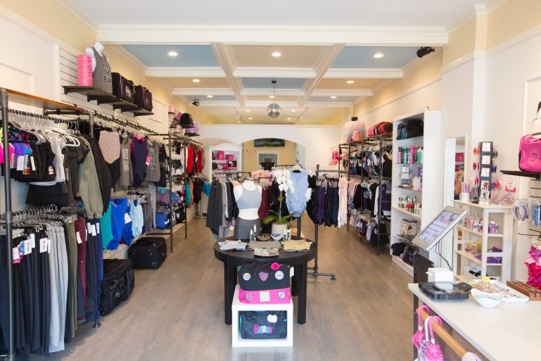 Beyond the Barre's store, featuring two walls full of merchandise and some tables and racks in the middle