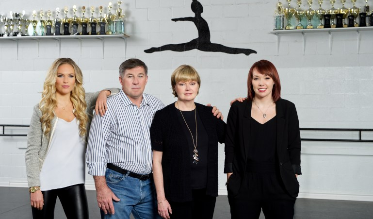 Joanne Chapman, her husband and her daughters pose together in their studio