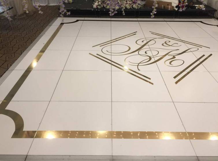 Portable white matte dance floor with gold sticker and border