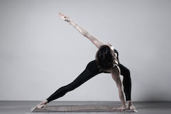 Anna Tetlow of Anna Tetlow Pilates practicing Garuda. Photo courtesy of Tetlow.
