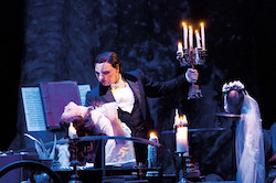 John Owen-Jones as the Phantom and Katie Hall as Christine in 'The Phantom of the Opera'. Photo by Michael Le Poer Trench.