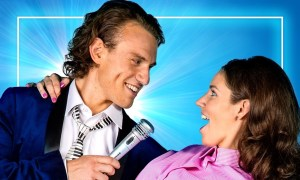 Christian Charisiou as Robbie Hart and Teagan Wouters as Julia in 'The Wedding Singer'.