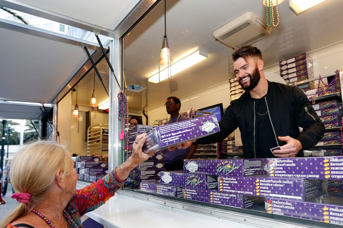 Country music artist Dylan Scott helps Crown Royal inspire generosity by passing out king cakes in exchange for Mardi Gras beads at the Crown Royal pop-up event on February 24, 2017 in New Orleans, Louisiana. (Photo by Tyler Kaufman/Getty Images for Crown Royal)