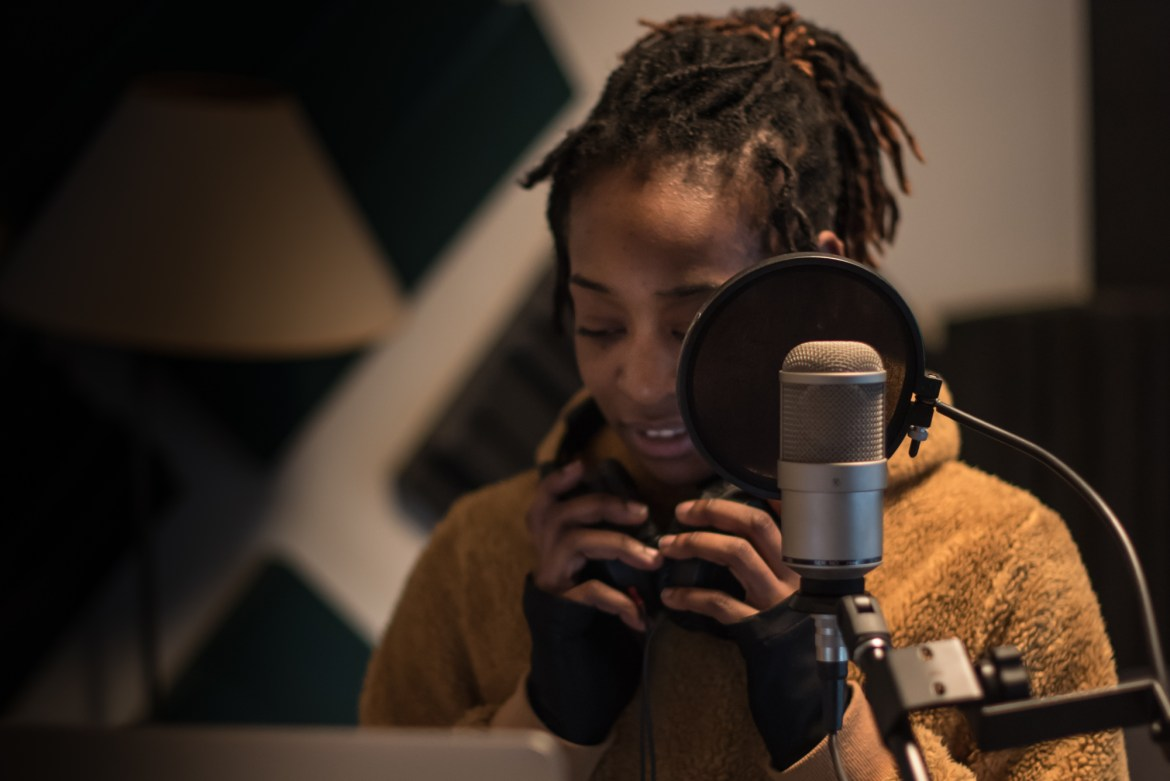 """Porscha Spells recording vocals for the score for Chicago Dance Crash's """"Lil Pine Nut"""" at Heart and Soul, Chicago, for the score design by Jessica Deahr and Johnny Nevin (Photo by Johnny Nevin)"""