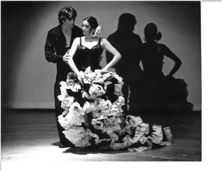 Young Dame Libby in performance of Bata de Cola with partner William Carter wearing traditional Spanish costume