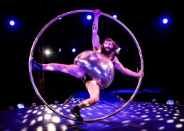 Antoine Carabinier-Lépine performs with a Cyr Wheel as part of the Barbu acrobatic troupe photocall on the Southbank - London