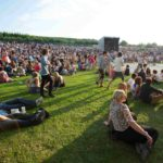 New York Governor Andrew Cuomo eases restrictions on large concert venuesOutdoor Concert Crowd