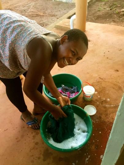 Teaching me how to wash clothes like a mugandan woman