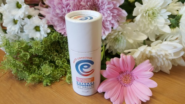 Earth Consicous Deodorant amongst pink flowers