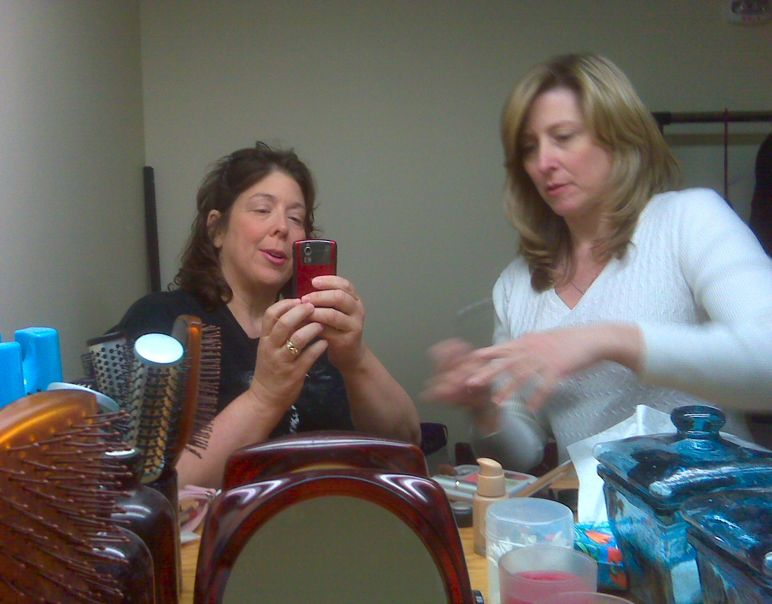 Priscilla came down to help out. Here we're putting on makeup before the shoot.