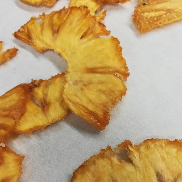 Donna's candying and drying pineapple for WHITE JADE bars. It'll be nice to have them back on the shelf. (Anabel fixed the dehydrator last week)#chocolatier #chocolate #pineapple #working