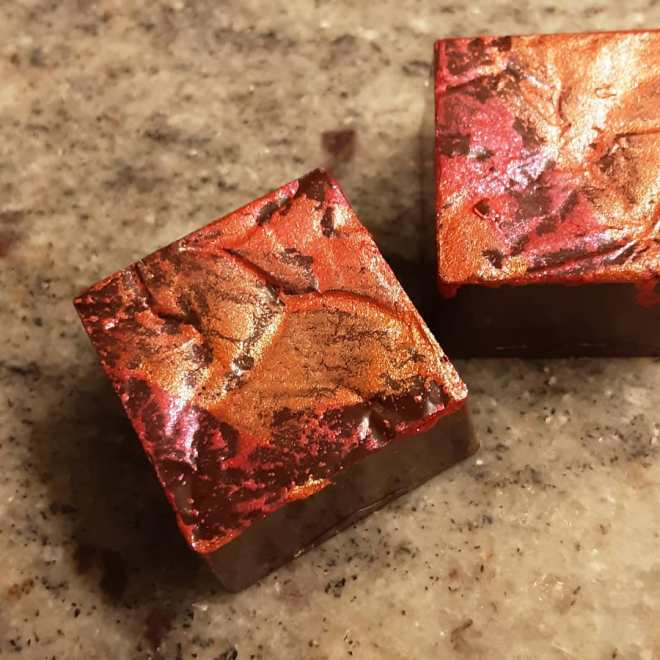 AD ASTRA - layers of blueberry and lemon-lime paté de fruit surrounded by soft brown sugar caramel. #chocolatier #notmonolithicMy God, it's full of stars!