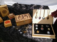 Wood burned boxes, Cameo rings, and amethyst topped with pewter figures.
