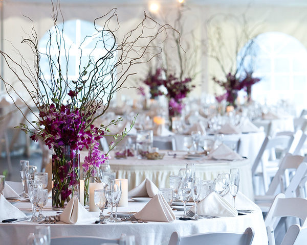 wedding tables set for fine dining at an event