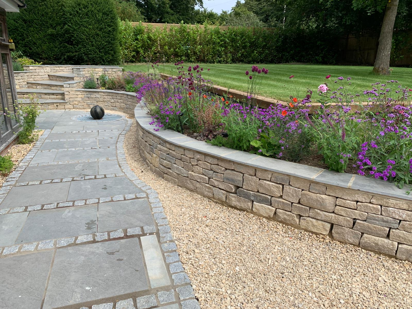 Stone curved raised bed
