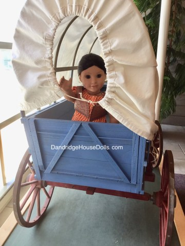 Josefina in a covered wagon.