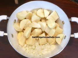 Place onion, potatoes and salt into a pot.
