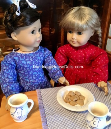Kirsten and her cousin Lisbeth sharing cookies.